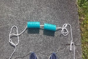 2 pieces of pool noodle on a rope to provide visual clue for jumping over the rope